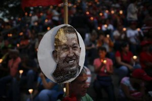 People hold lit candles during a praying ceremony for the health of Venezuelan President Chavez in Caracas